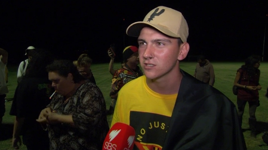 Dylan Voller protested outside the Carrara Stadium.