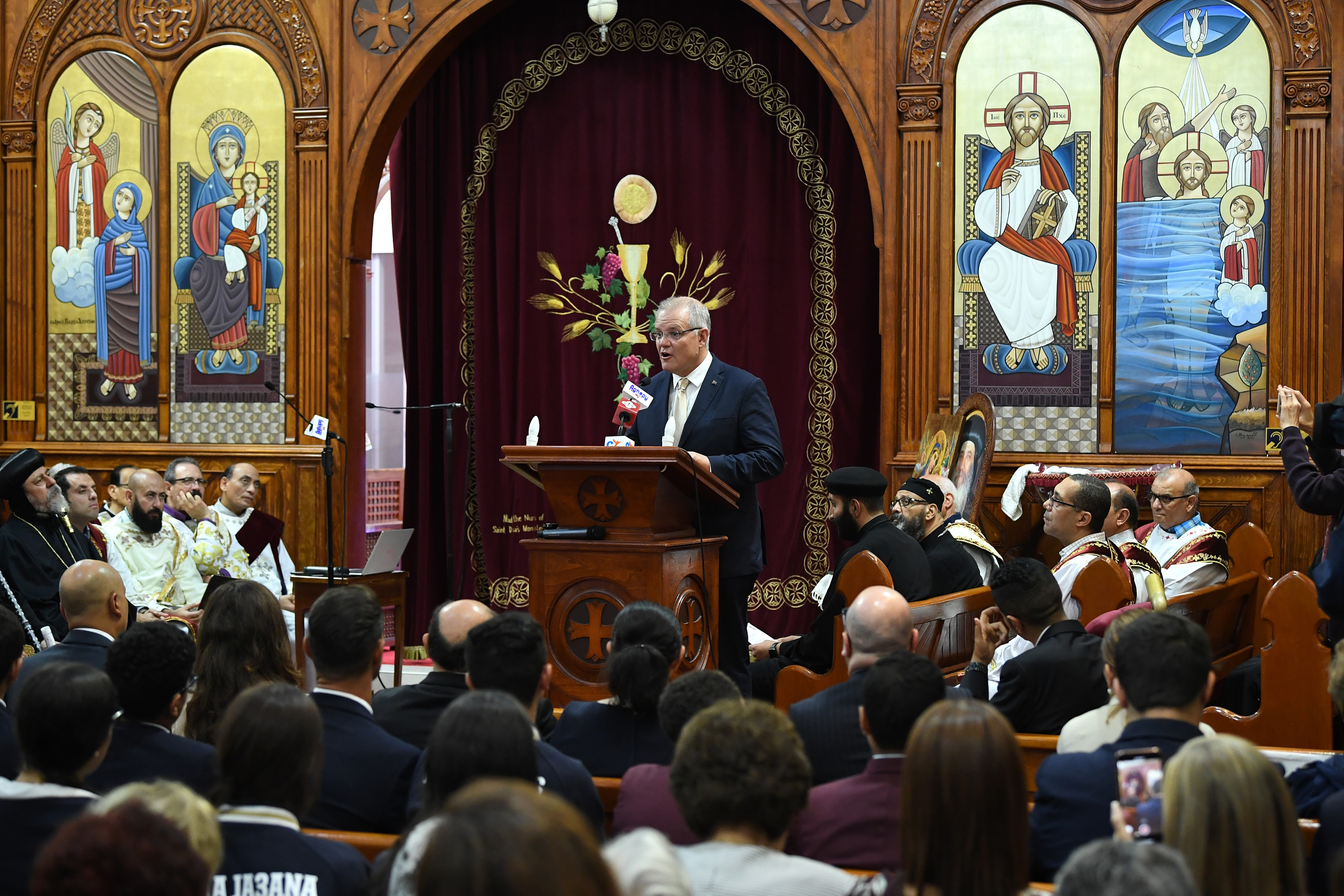 Prime Minister Scott Morrison speaks during Mass at St Mark Coptic Orthodox Church at Arncliffe in Sydney, Sunday, March 17, 2019. (AAP Image/Joel Carrett) NO ARCHIVING