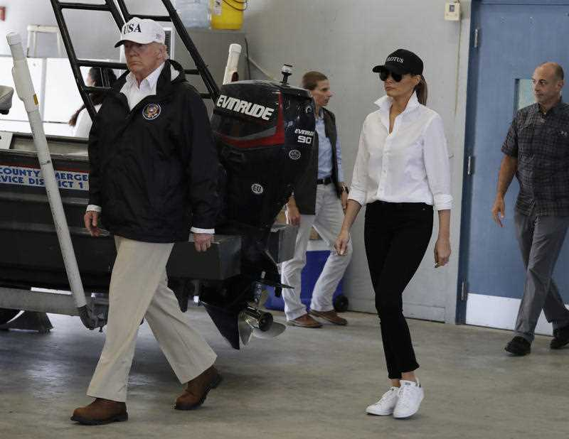 resident Donald Trump and first lady Melania Trump arrive take part in a briefing on Harvey relief efforts, Tuesday, Aug. 29, 2017, at Firehouse 5 in Corpus Christi, Texas. (AP Photo/Evan Vucci)