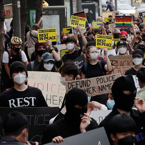 People march to protest during a solidarity rally for the death of George Floyd in Seoul, South Korea, Saturday, June 6, 2020. Floyd died after being restrained by Minneapolis police officers on May 25.(AP Photo/Ahn Young-joon)