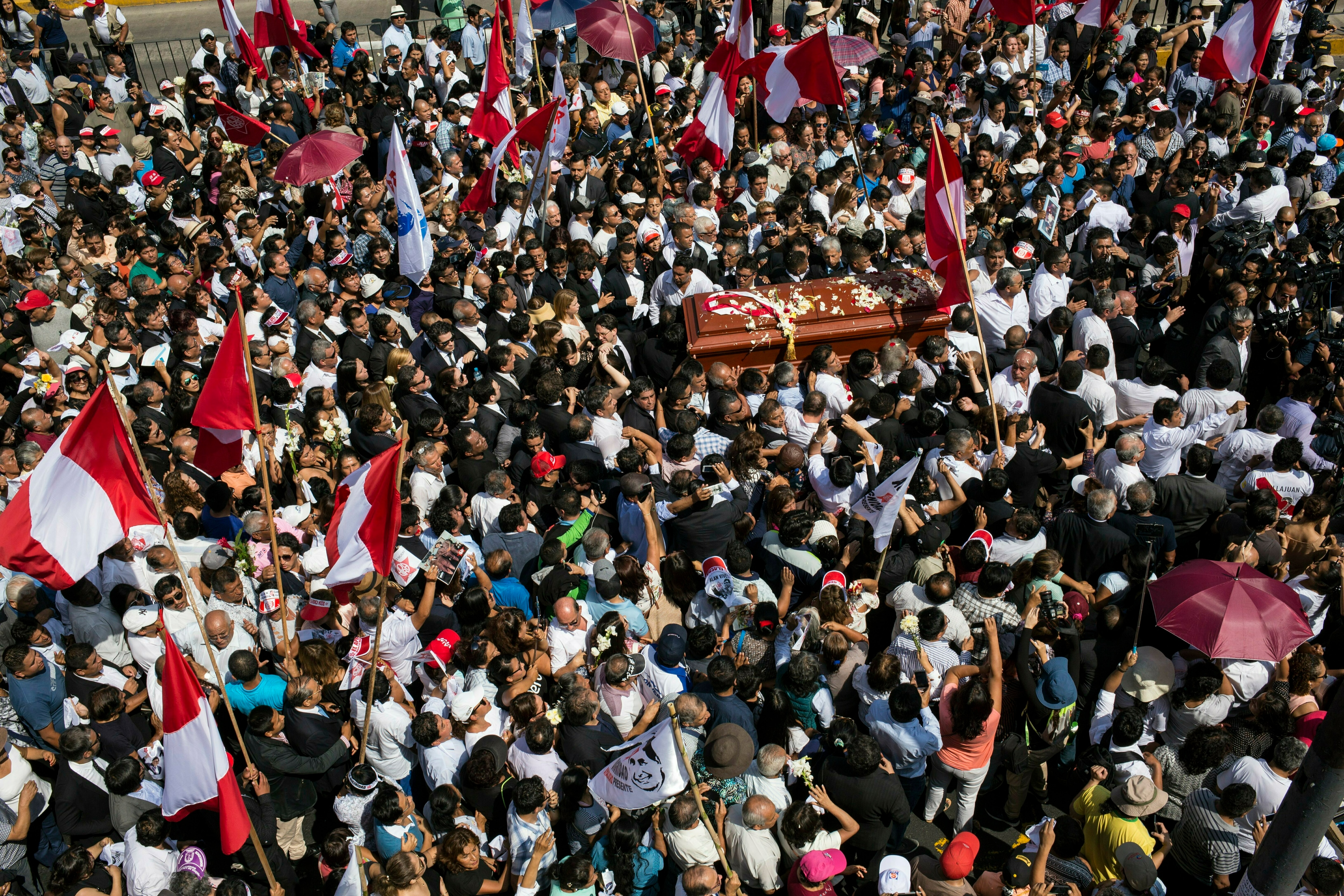 People carry the coffin of Peru's late President Alan Garcia during his funeral procession in Lima, Peru.