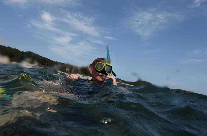 One Nation Senator Pauline Hanson snorkels on the Great Barrier Reef off Great Keppel Island.