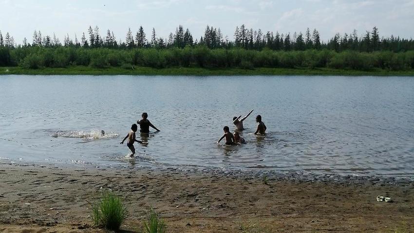 Children play in the Krugloe lake outside Verkhoyansk, Siberia.