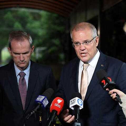 Immigration Minister David Coleman (left) and Prime Minister Scott Morrison.