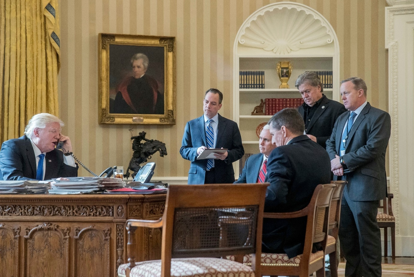 President Donald Trump, along with current and former staffers, including Steve Bannon (second from right) (AAP)