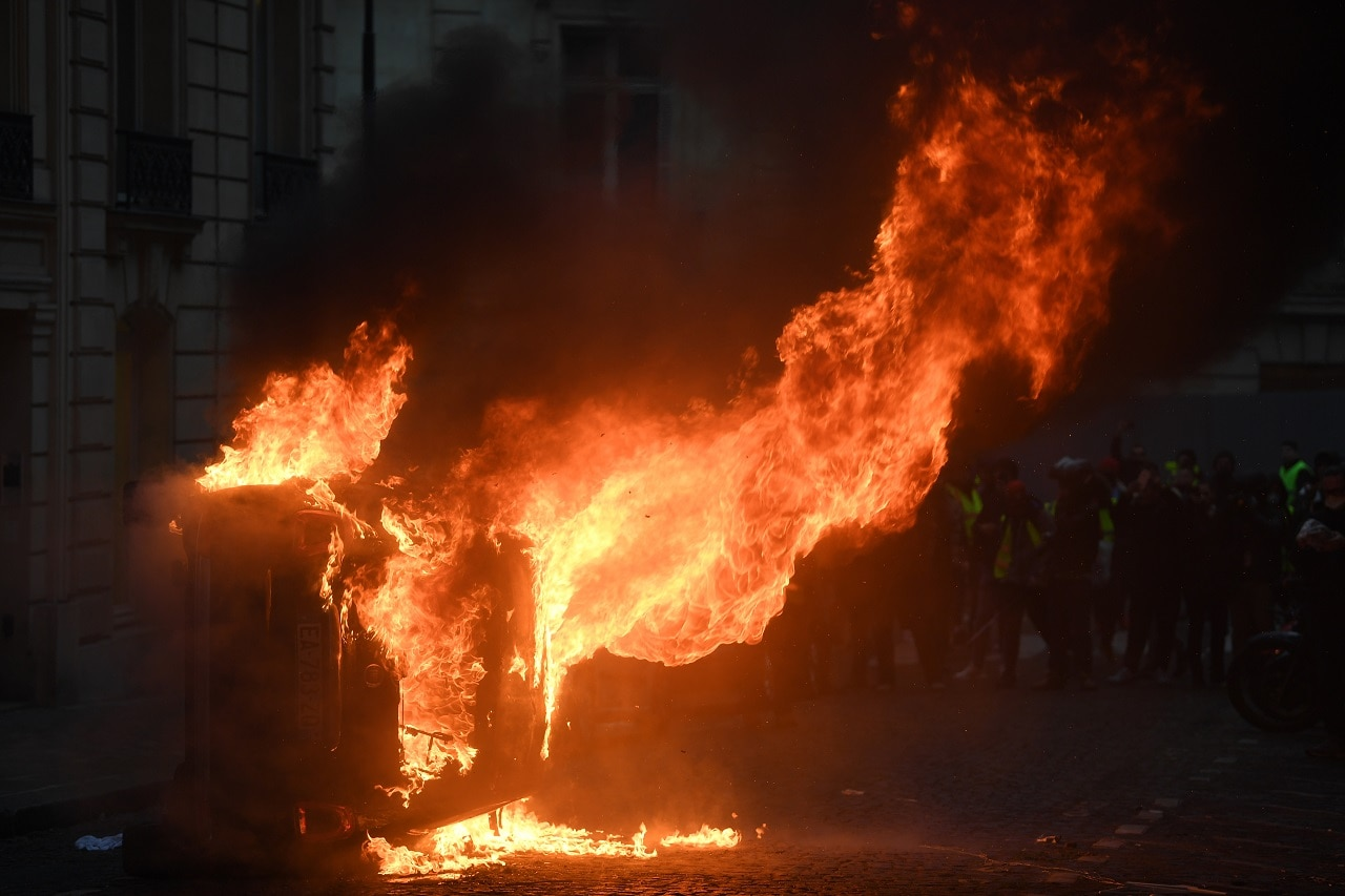 French president Macron will cut taxes, raise minimum wage following violent protests