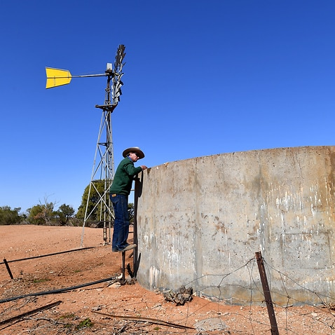 Pastoralist Lachlan Gall checks the water tank on his property at Langawirra Station north of Broken Hill, New South Wales, Monday August 20, 2018