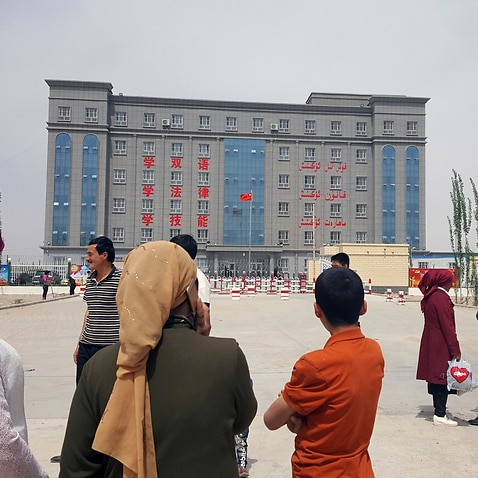 A sign describes this facility on the edge of Hotan, a city in Xinjiang, as a concentrated transformation-through-education center.