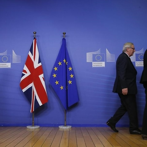 A file image of Michel Barnier, Jean-Claude Juncker and Theresa May