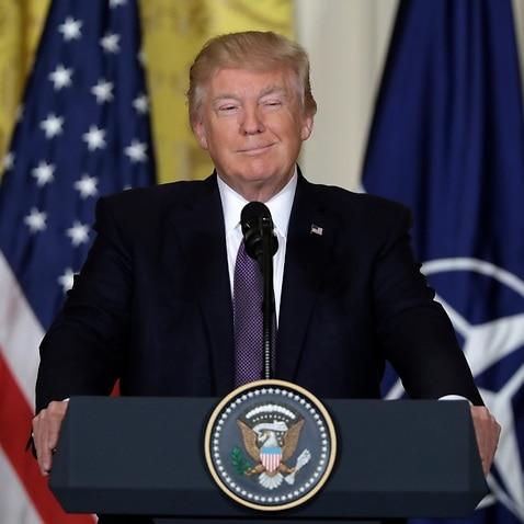 US President Donald J. Trump (R) and NATO Secretary General Jens Stoltenberg (L)
