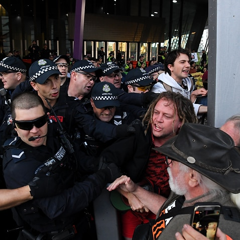 Environmental protesters clash with Police outside the Melbourne Exhibition and Convention Centre in Melbourne.