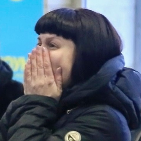 Relatives and friends of those on the Saratov Airlines airline plane An-148 flight that crashed near Moscow's airport Domodedovo react.