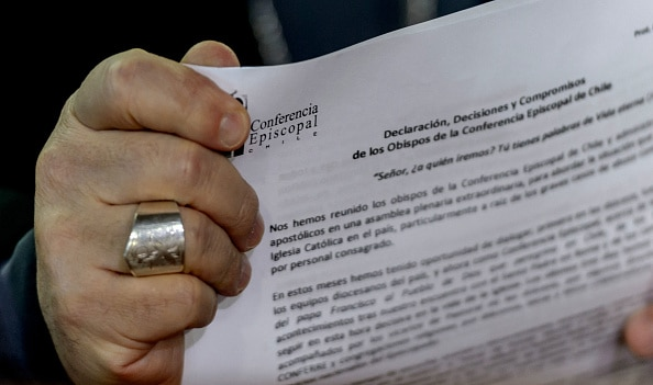 Monsignor Fernando Ramos, holds the apology  during a press conference in Punta de Tralca, west of Santiago.