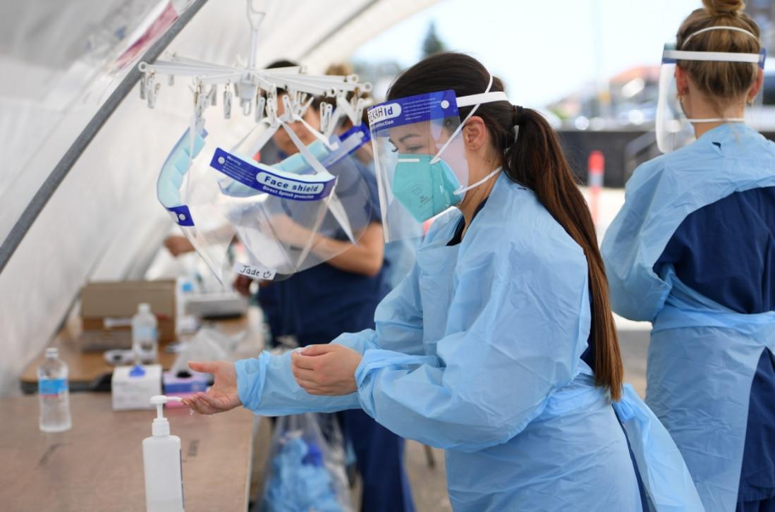 Nursing staff are seen at a coronavirus testing facility at Bondi Beach in Sydney, Thursday, October 15, 2020.
