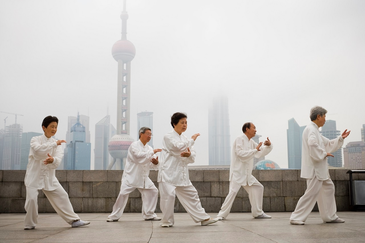 A group practicing Tai Chi in China.