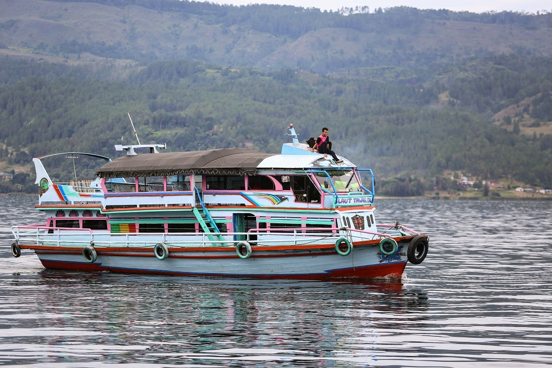 A boat similar to the KM Sinar Bangun, a ferry that capsized 18 June, travels on Lake Toba.
