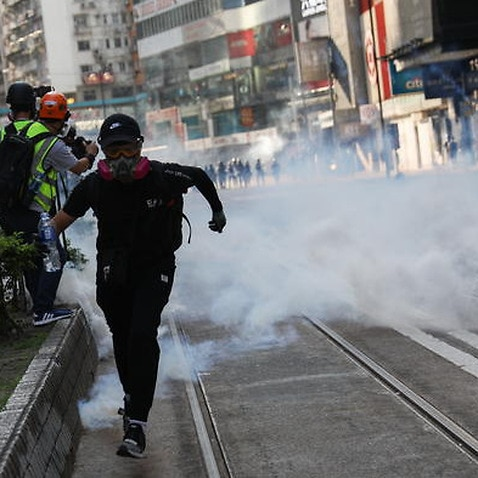 A protester runs after the police fired tear gas during a pro-democracy rally in Hong Kong, China, 02 November 2019.