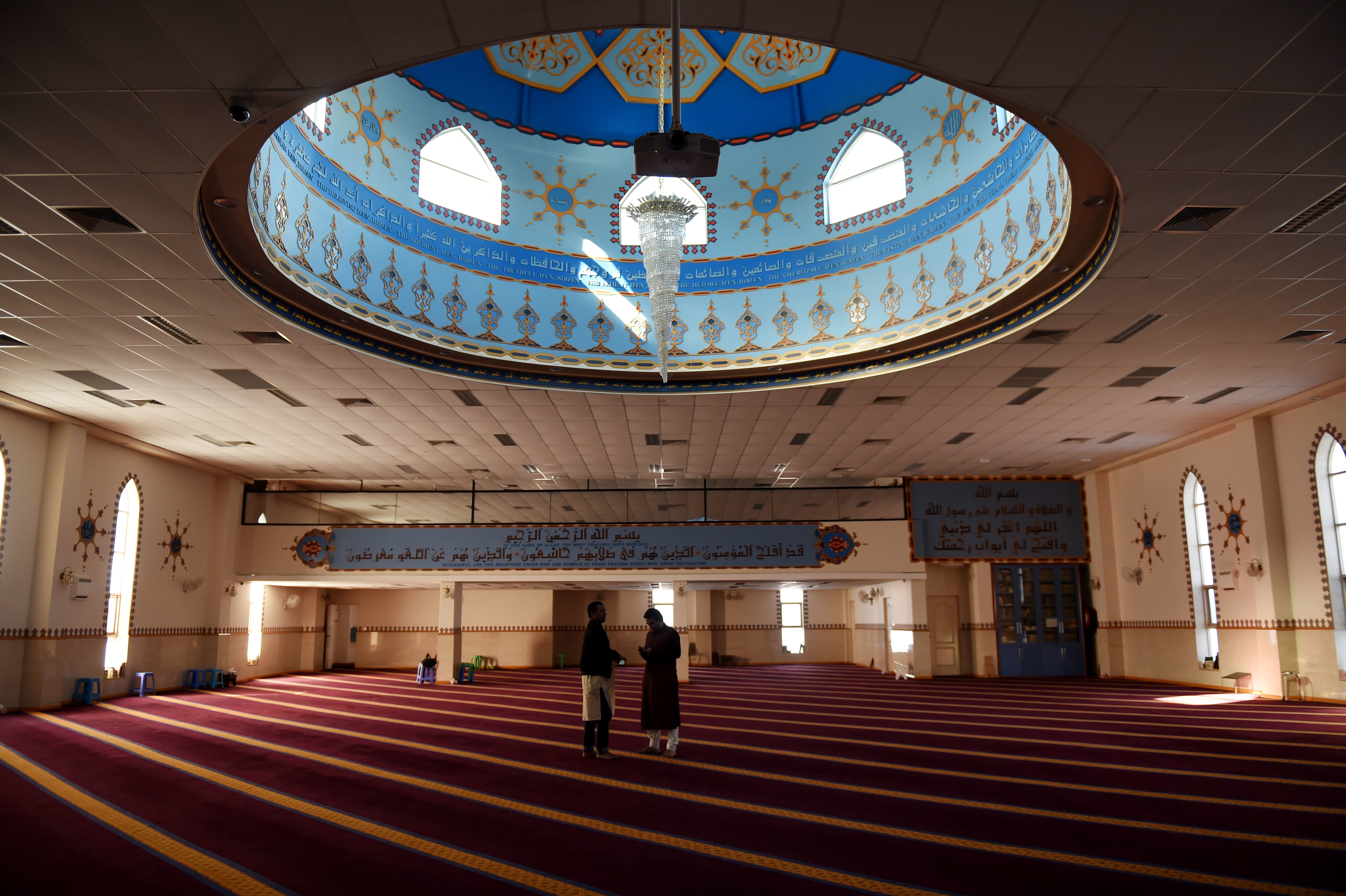 Men gather to pray at Lakemba Mosque in Sydney, Friday, Aug. 22, 2014. (AAP Image/Tracey Nearmy) NO ARCHIVING, EDITORIAL USE ONLY