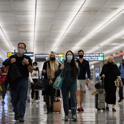 Travellers walk through Washington's Dulles International Airport in Dulles, Virginia, in November 2020.