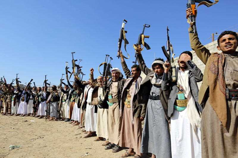 Houthi rebel fighters brandish their weapons in Yemen. Fighting continues, despite a peace deal being hammered out by the various parties.