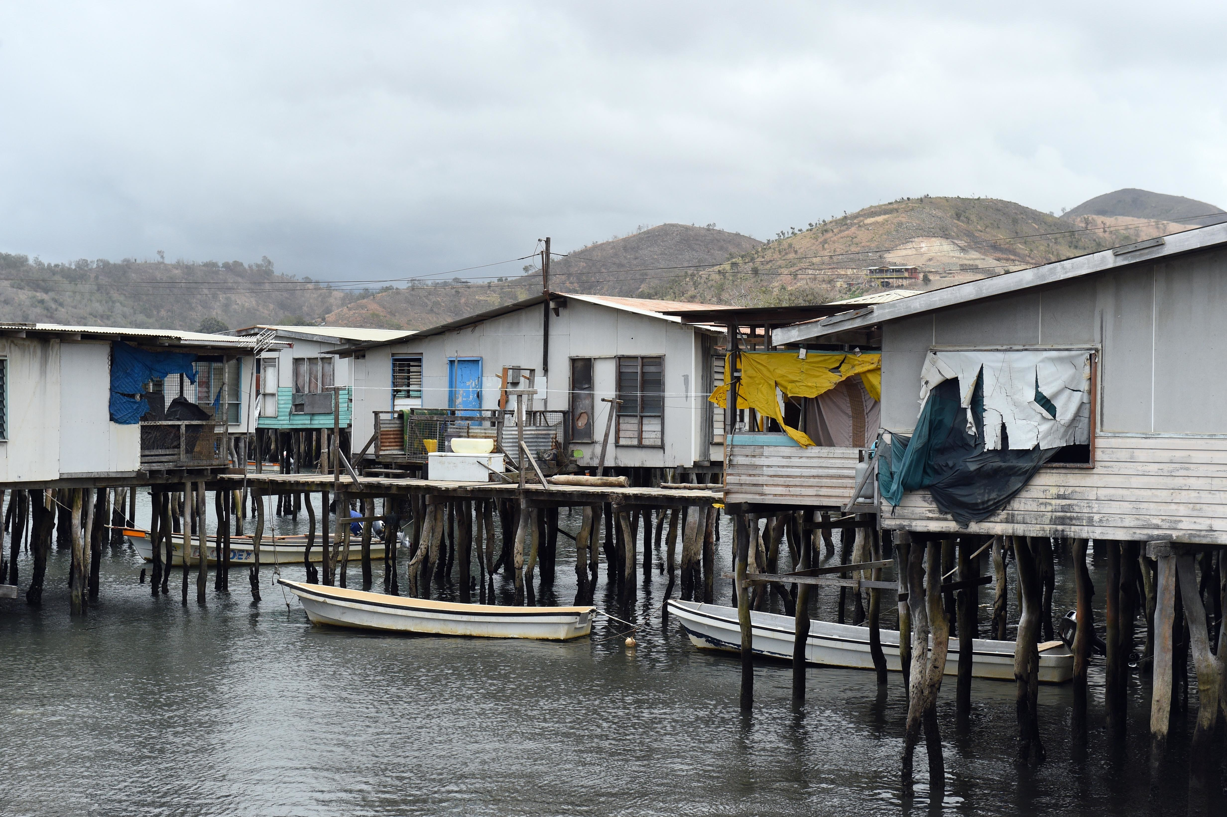 Boats are moored outside homes in the stilted village of Hanuabada near Port Moresby, Papua New Guinea.
