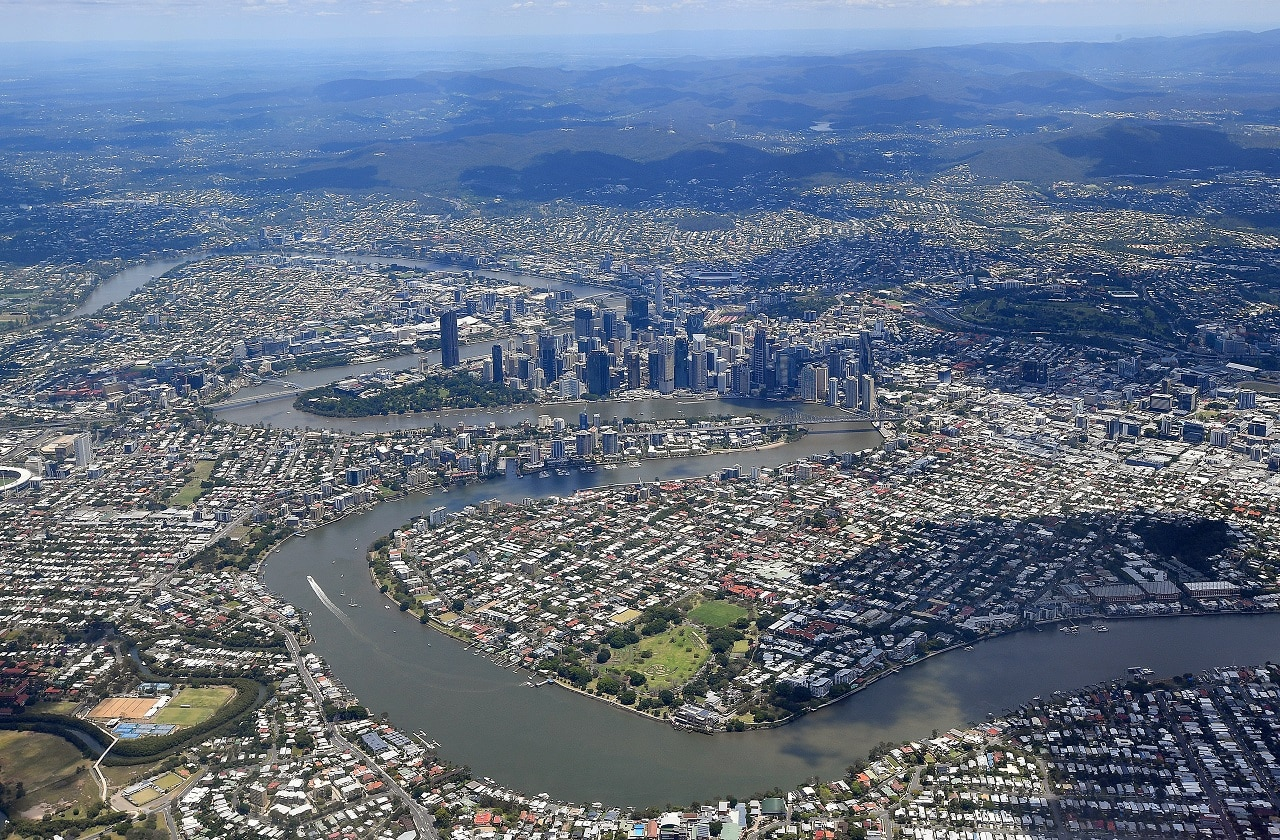 An aerial view of the Brisbane river and the city of Brisbane.