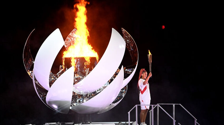 Image for read more article 'In a near-empty stadium, Naomi Osaka lights the Olympic flame to open the Tokyo Games'