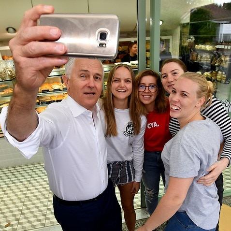 Malcolm Turnbull takes a selfie during a street walk with LNP leader Tim Nicholls.
