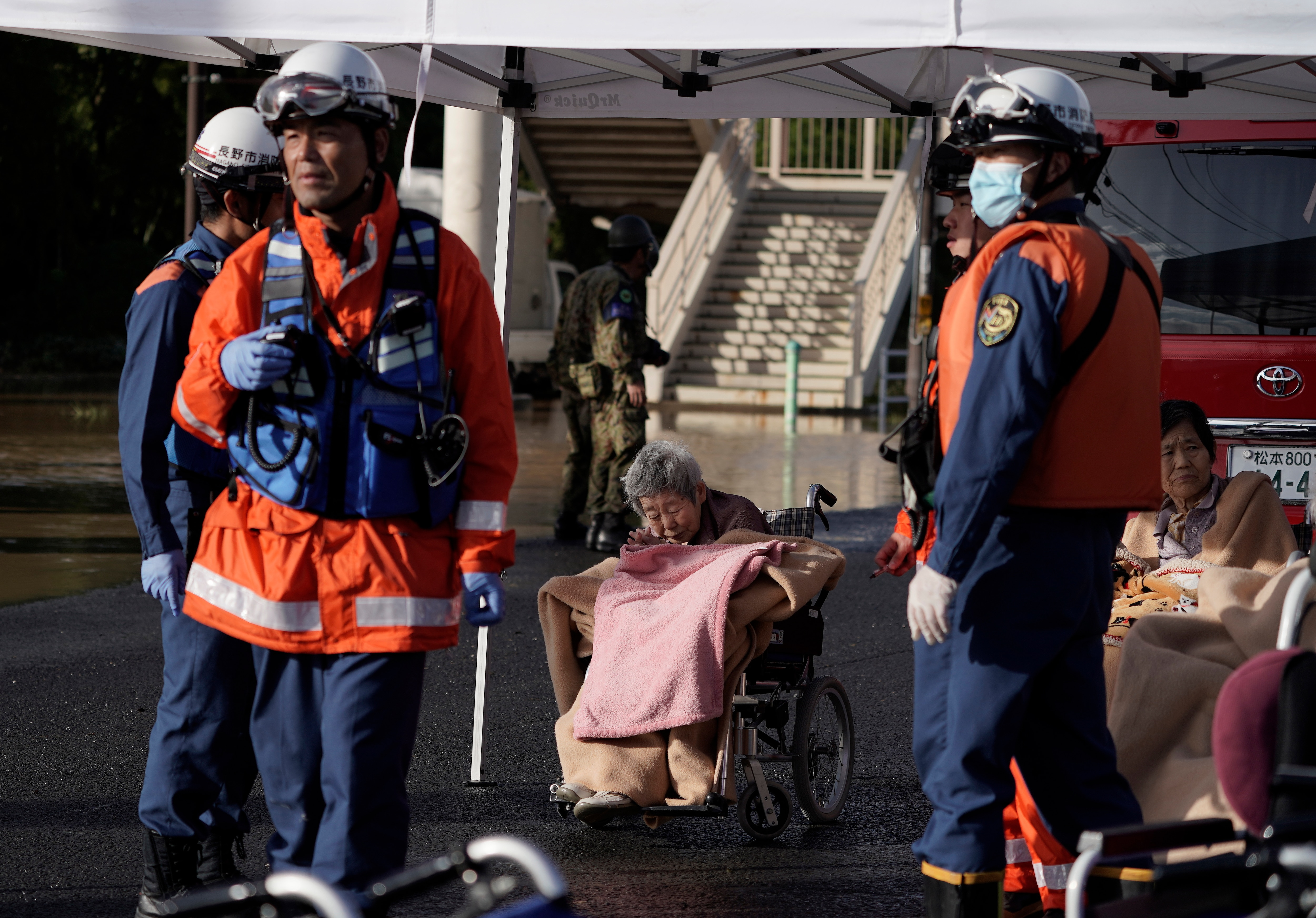 An elderly woman was evacuated along with others from a nursing home flooded by Typhoon Hagibis, before being moved to another facility in Nagano.