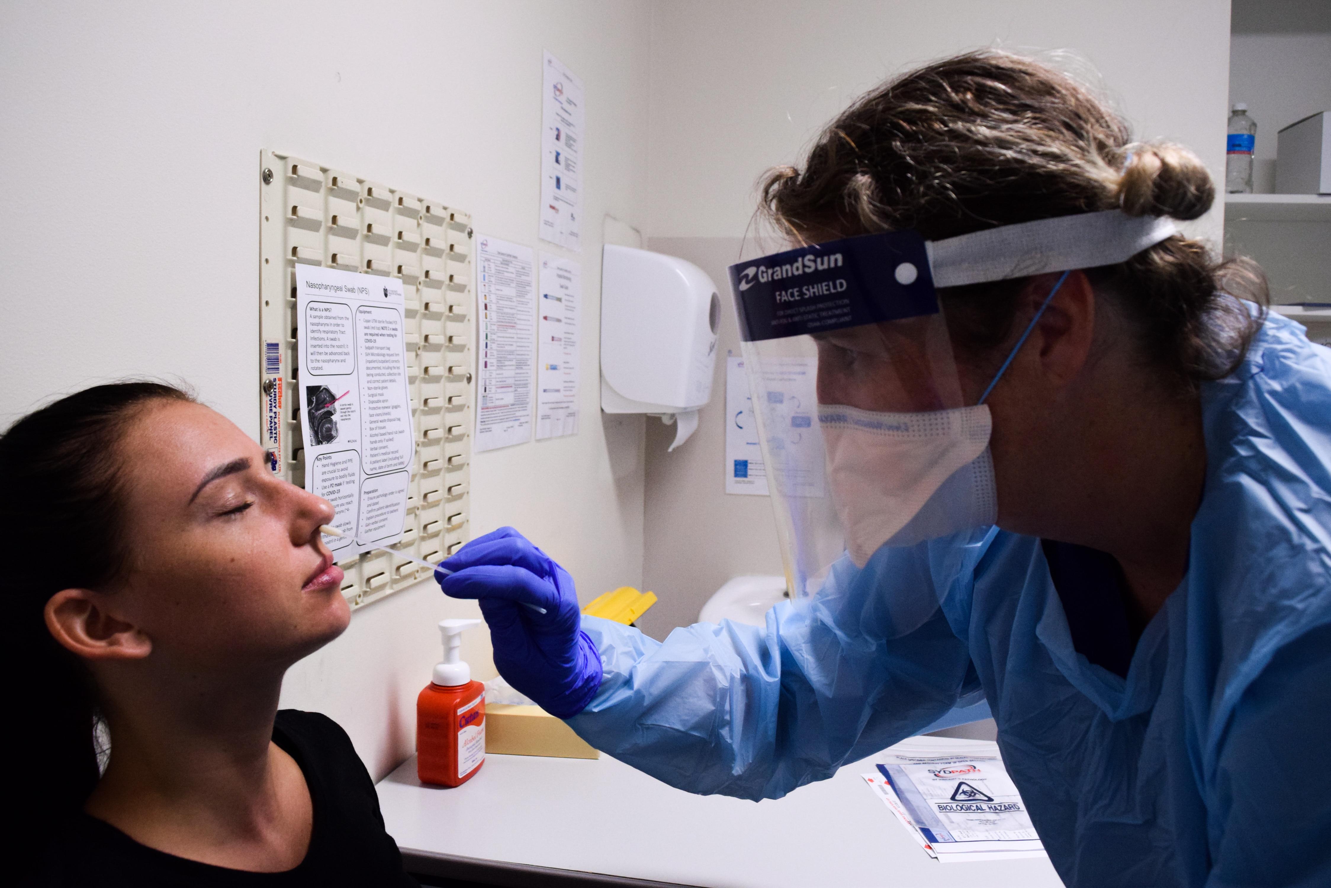 A woman is tested for COVID-19 at St Vincent's Hospital in Sydney.