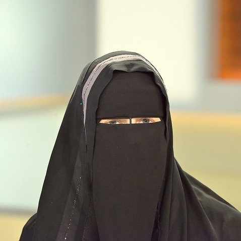 A picture made available 07 November 2016 shows member of the Islamic Central Council Switzerland Nora Illi (L) wearing a niqab.