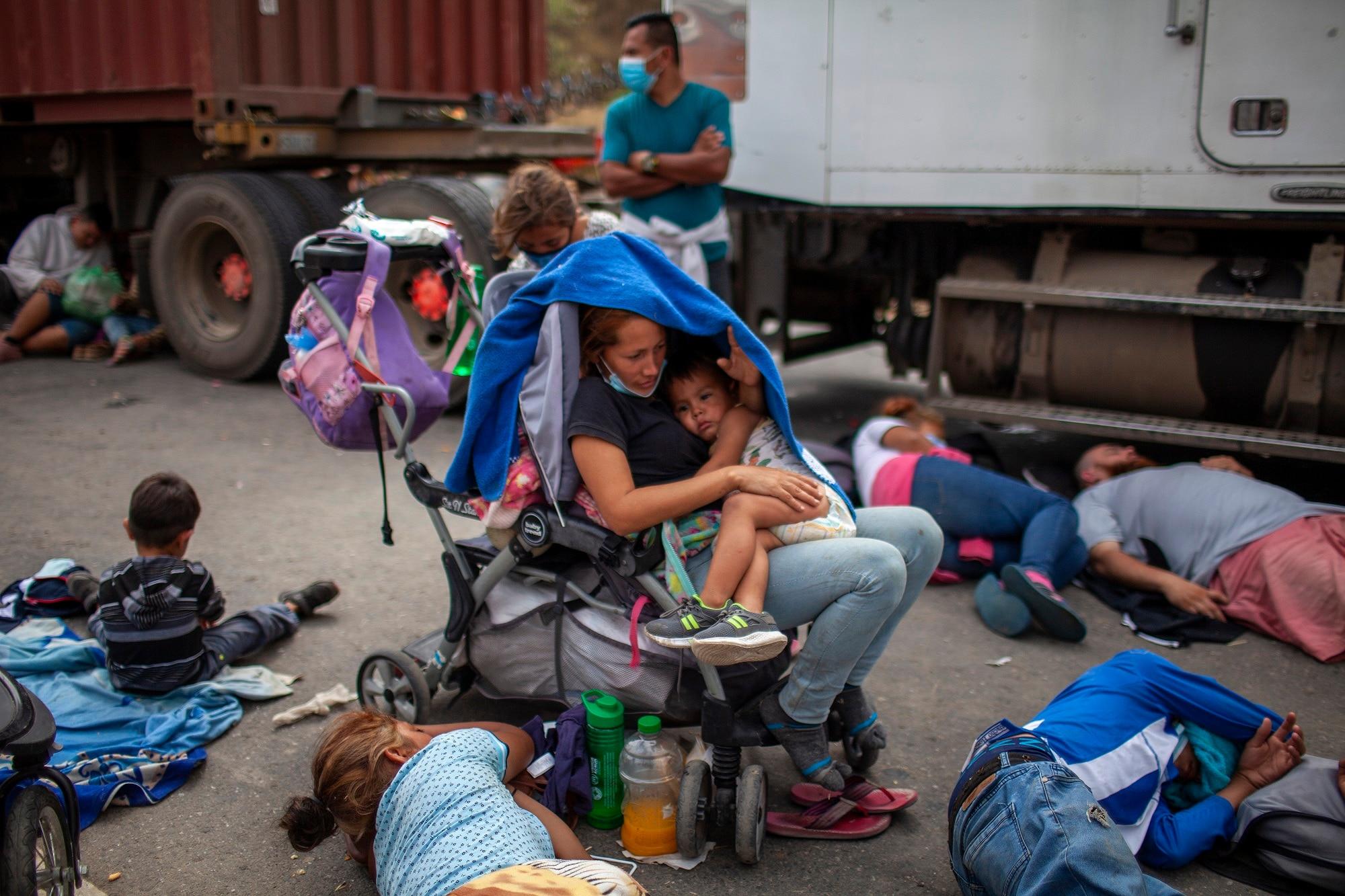 Honduran asylum seekers camp on a highway in Vado Hondo, Guatemala.