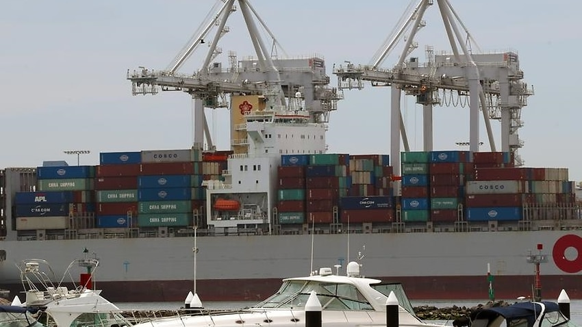 A cargo ship is seen being loaded at Port Melbourne