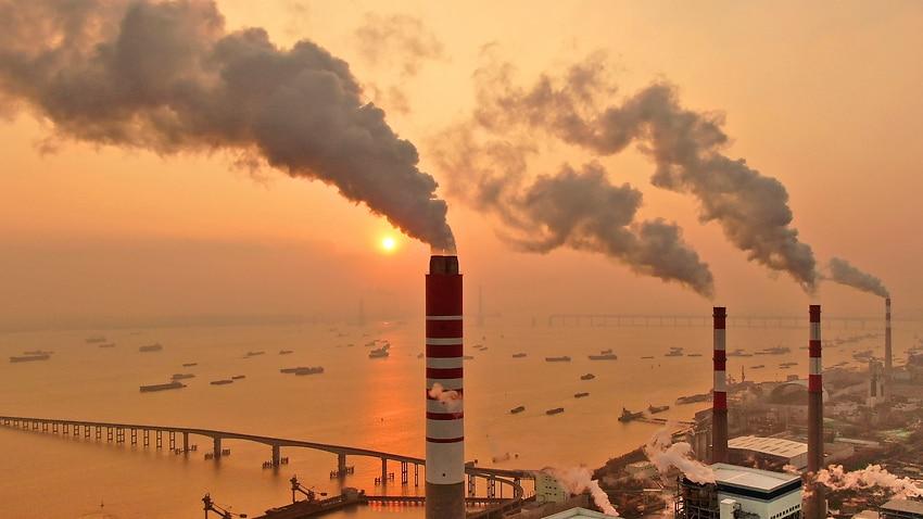 The sun sets near a coal-fired power plant on the Yangtze River in Nantong in eastern China's Jiangsu province