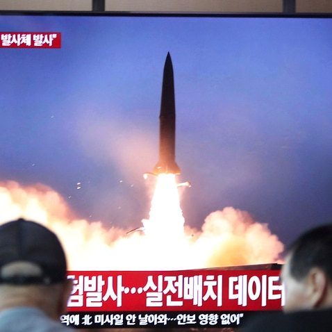 People watch a TV showing a file footage of North Korea's missile launch during a news program at the Seoul Railway Station, South Korea, Friday, Aug. 2, 2019.