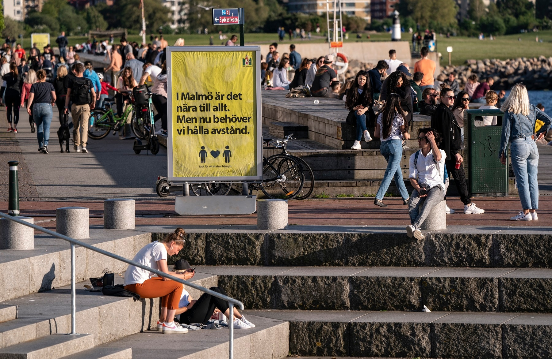 People enjoy the warm evening weather in Malmo, Sweden