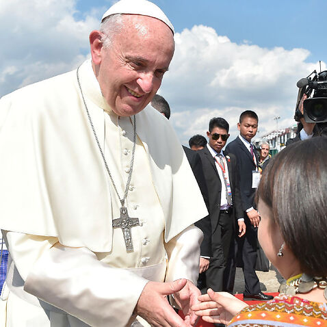 Pope Francis arrives in Yangon, Myanmar.