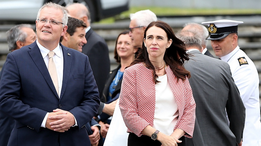 Scott Morrison and Jacinda Ardern look at the cenotaph as they walk towards the wreath laying ceremony at the War Memorial Museum in Auckland.