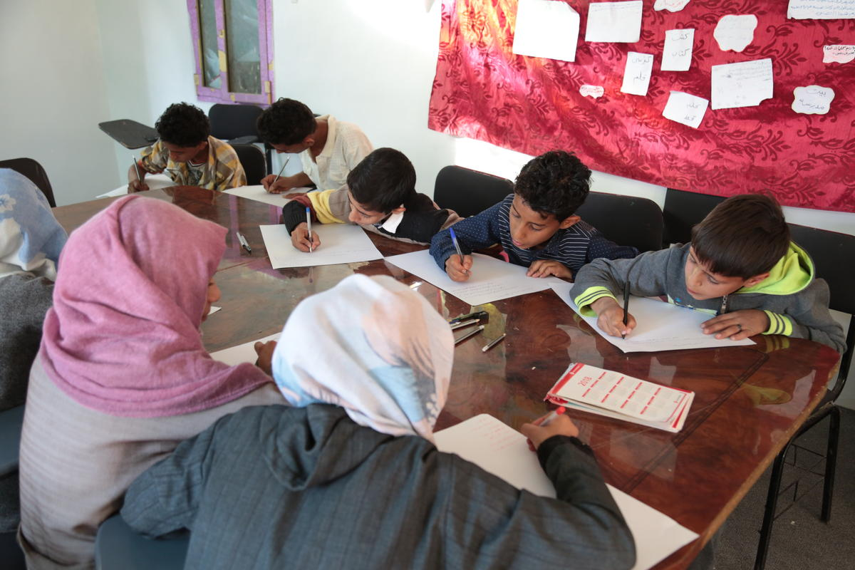 Children at a Child Friendly Space in Sana'a drafting a resolution for the war in Yemen.