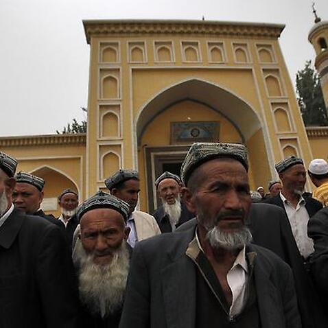 Muslim Uighur men leave the Id Kah Mosque after Friday prayers in Kashgar, Xinjiang Uighur Autonomous Region, China, 24 May 2013.