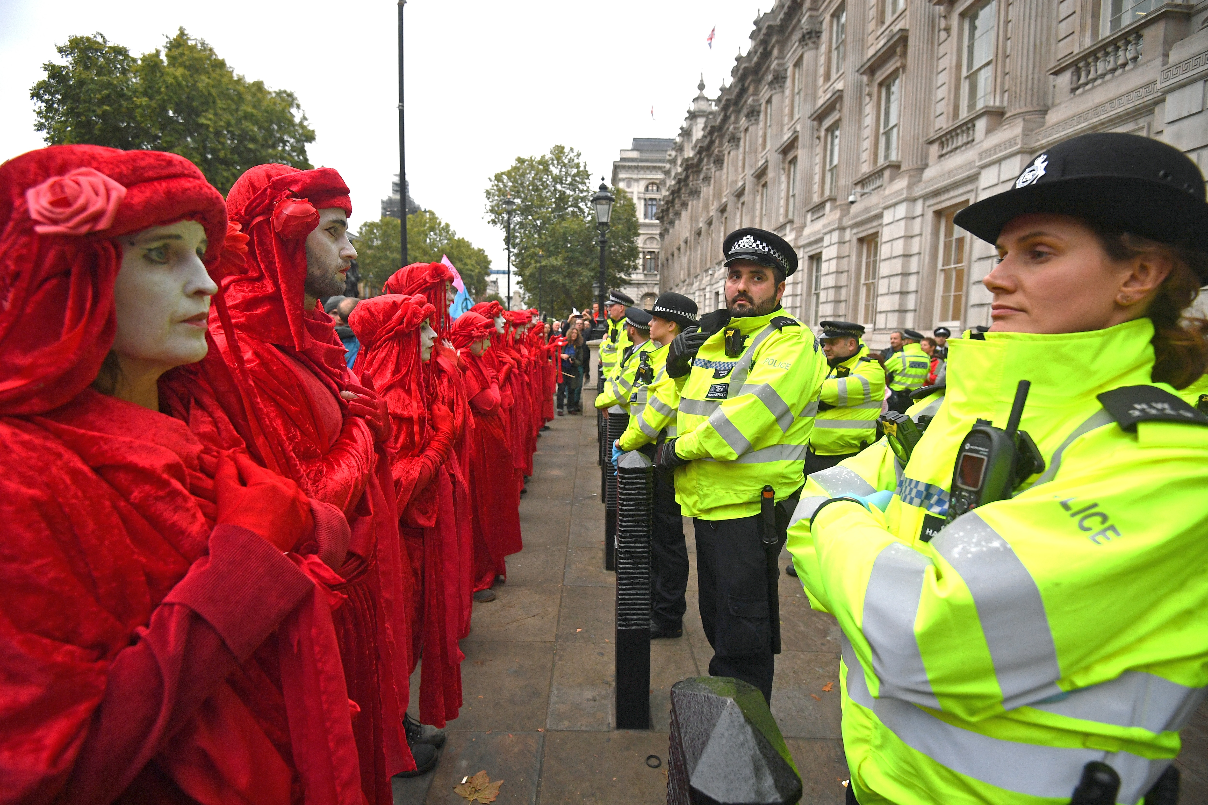 Protesters, dubbed the Red Rebels, outside the Cabinet Office on Whitehall, during an Extinction Rebellion (XR) protest in Westminster, London.