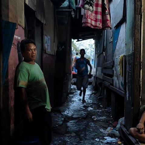 Edwin Panis in the alleyway of a slum near where he was seized in the Tondo district of Manila.