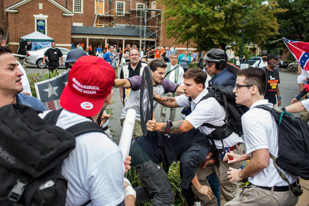 Violent clashes erupt at the 'Unite the Right' rally in Charlottesville on 12 August 2017.