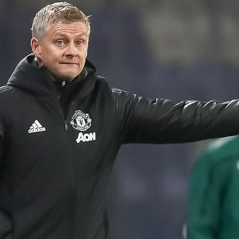 Ole Gunnar Solskjaer reacts during a Manchester United match