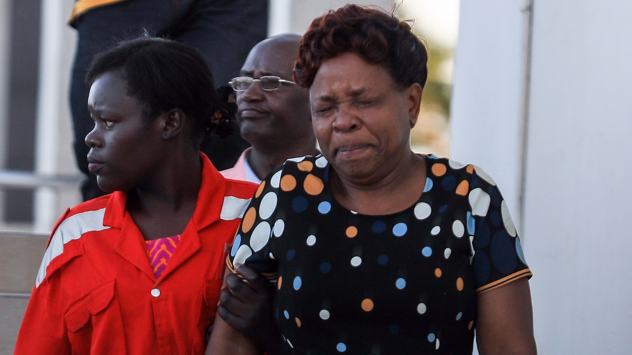 A Kenyan woman (R) is comforted by a Red Cross worker (L), after getting information about her loved ones that were on board the Ethiopian Airlines Flight 302.