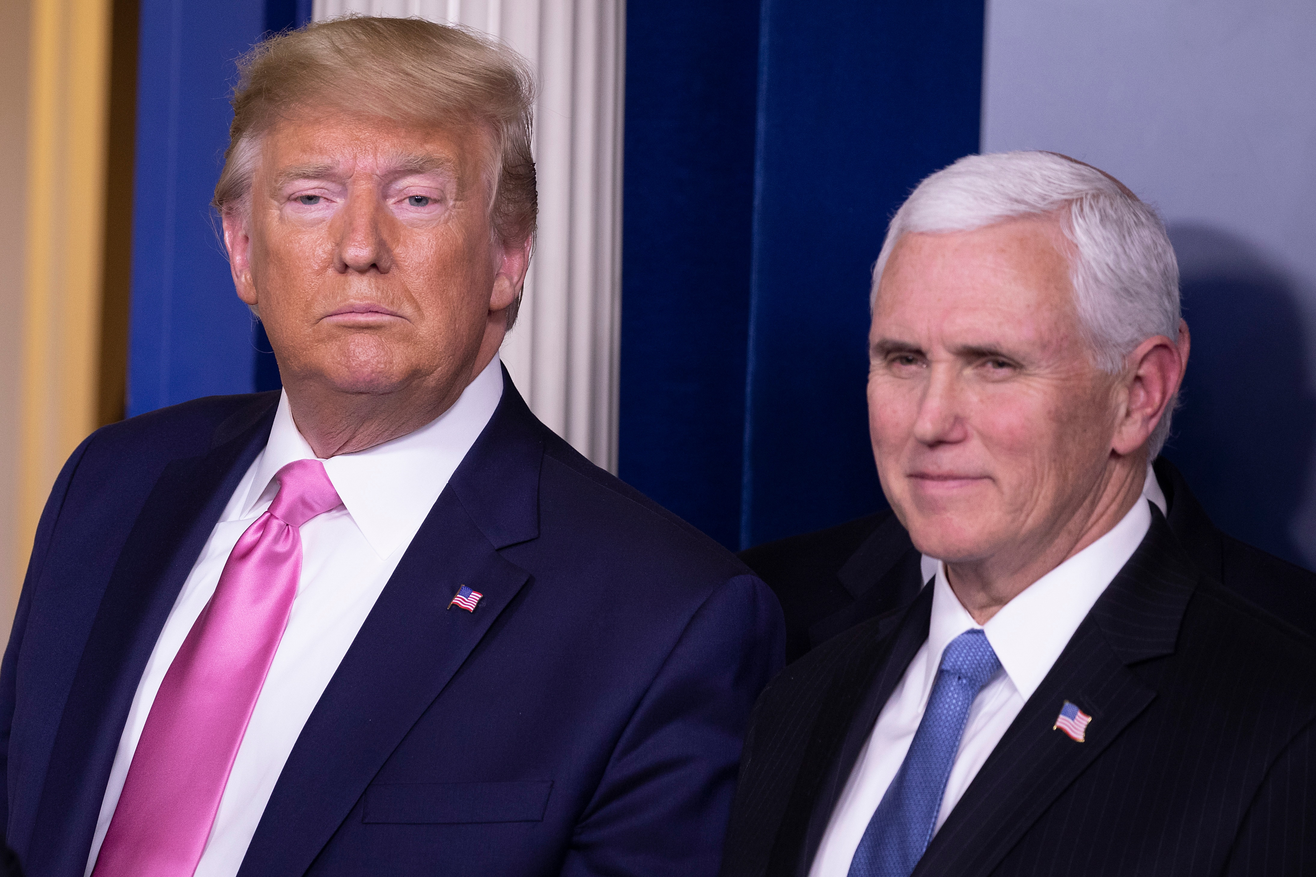U.S. President Donald Trump looks on after a news conference with Vice President Mike Pence.