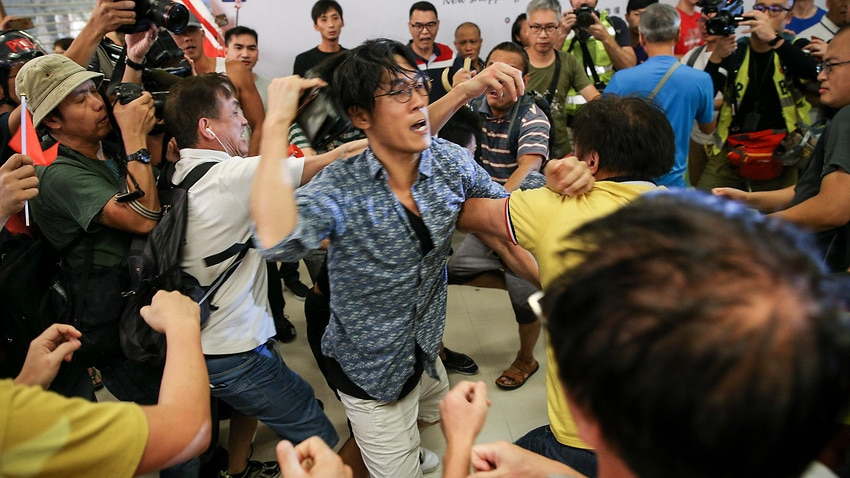 Hong Kong police move in to break up shopping mall protest clashes