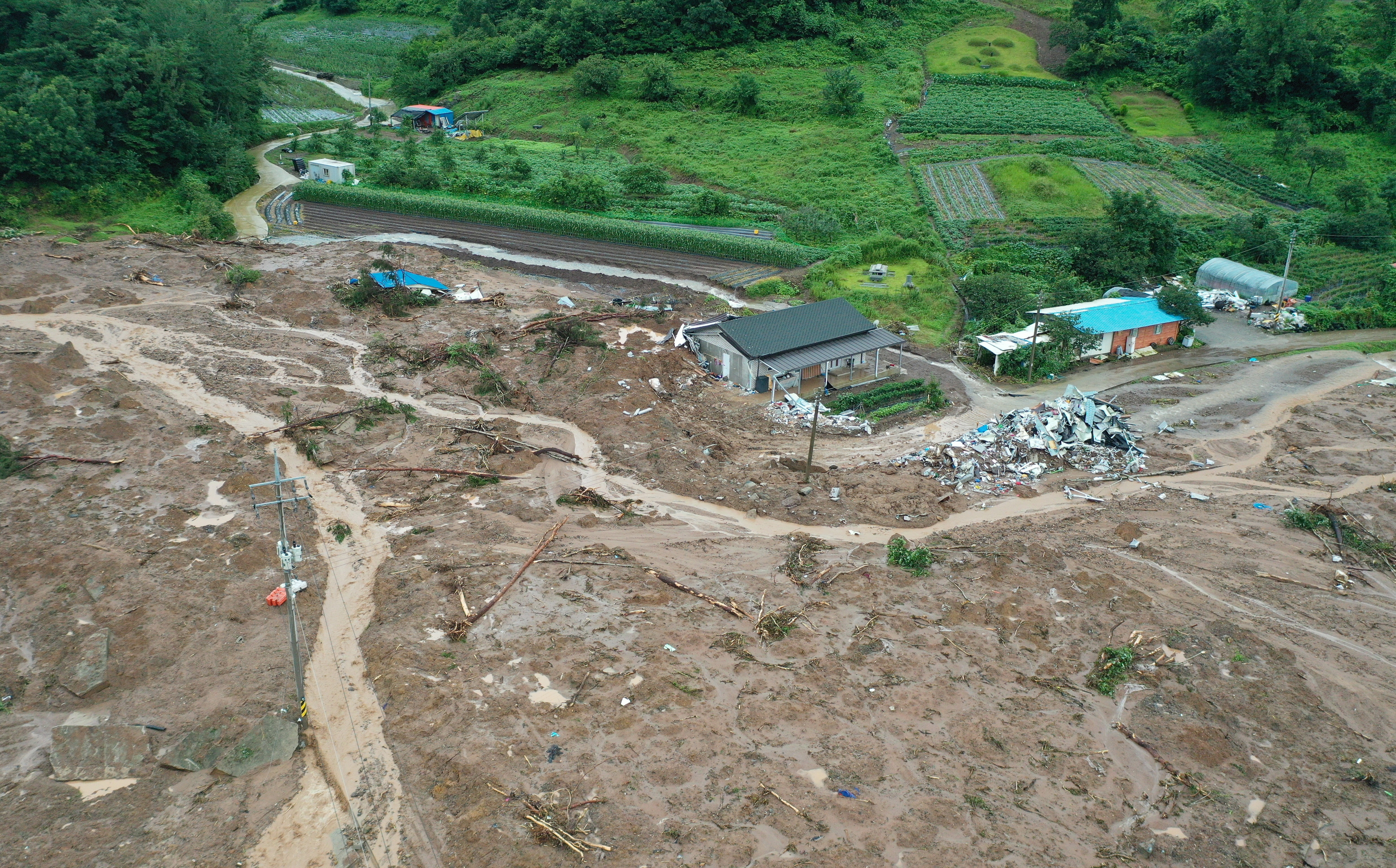 A general aerial view of a village that was devastated by a landslide the previous day,  in the southwestern county of Gokseong, South Korea