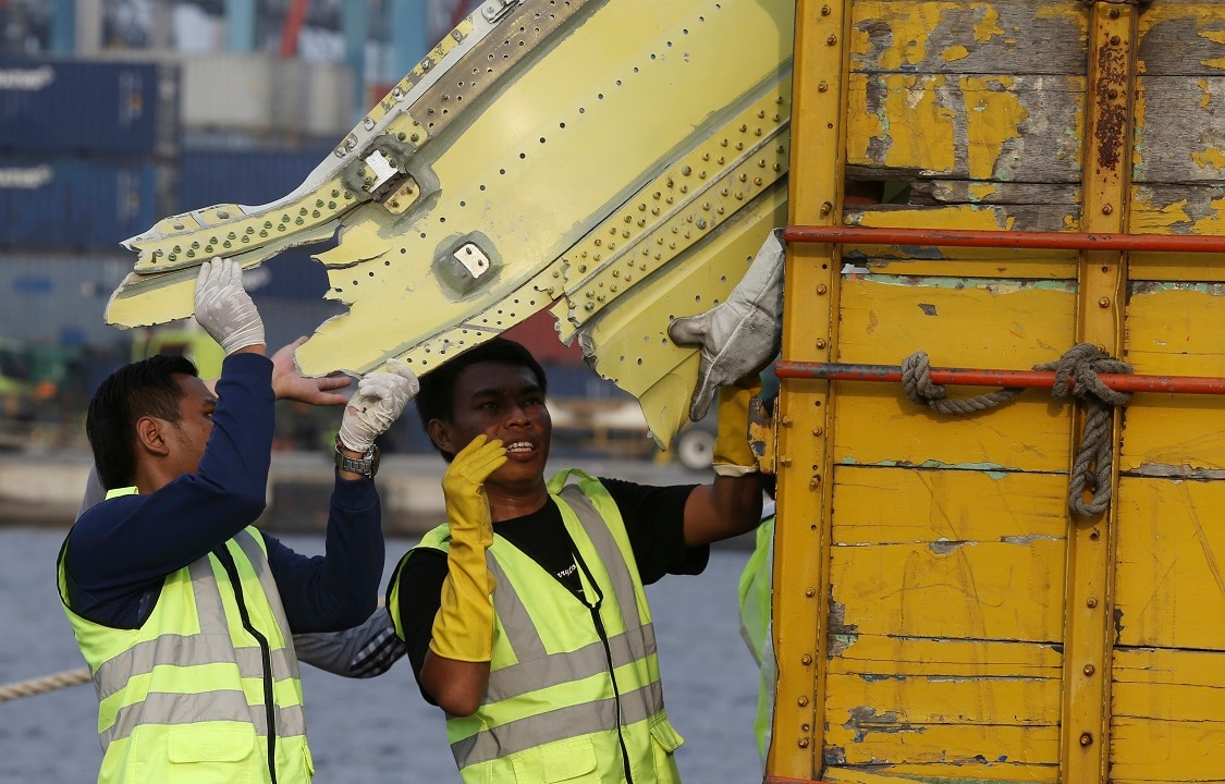 Officials move pieces of wreckage from the crashed Lion Air jet for further investigation.