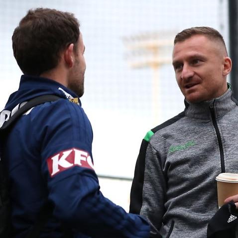 Leigh Broxham and Besart Berisha exchange words before departing Melbourne